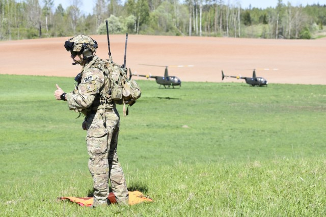 U.S. Air Force Tech Sgt. Laurence Paradis, Tactical Air Control Party member with Okla. National Guard's 146th Air Support Operations Squadron, advises Estonian Defense Force on Joint Terminal Attack Controller capabilities May 9th during Exercise HEDGEHOG 2018 in Southern Estonia. The TACP personnel served as advisers to the Estonian Defense Force to create combined fires between U.S. Army and multinational aviation assets.