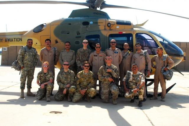 The 449th Combat Aviation Brigade, United Kingdom Training Team 1 (Armored Medical Regiment) and Iraqi army aviation medical staff pose for a group picture to commemorate the inaugural class of the aeromedical evacuation training course facilitated by the 449th CAB at Camp Taji, Iraq, April 22-May 3. The 10-day train-the-trainer course focused on the concepts of Tactical Combat Casualty Care and is part of the overall Combined Joint Task Force - Operation Inherent Resolve building partner capacity mission which focuses on training and improving the capability of partnered forces fighting ISIS.