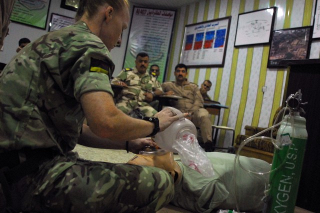 Staff Sgt. Natalie Jackson, assigned to the U.K. Training Team 1, Armored Medical Regiment, demonstrates how to bag valve mask on a medical dummy during a 10-day aeromedical evacuation training course facilitated by the 449th Combat Aviation Brigade, which requires Iraqi students to simulate providing point-of injury care and medical evacuations to a multi-trauma patient at Camp Taji, Iraq April 22-May 3. The 10-day train-the-trainer course focused on the concepts of Tactical Combat Casualty Care and is part of the overall Combined Joint Task Force - Operation Inherent Resolve building partner capacity mission which focuses on training and improving the capability of partnered forces fighting ISIS.