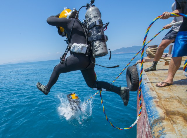 For Army divers, excavating underwater tombs is a solemn, honorable duty