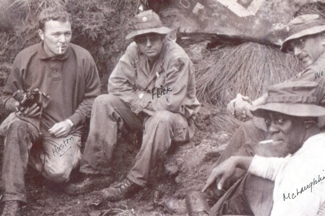 Johnie Webb, upper right, deputy of outreach and communications for the Defense POW/MIA Accounting Agency, sits with team members during a recovery mission in Papua New Guinea in 1978. Webb, a retired lieutenant colonel and Vietnam War veteran, has worked for the agency for 40 years to help families reunite with their lost loved ones.