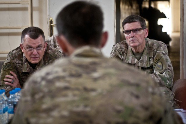 U.S. Army Lt. Gen. Paul E. Funk, commander of Combined Joint Task Force -- Operation Inherent Resolve, and U.S. Army Gen. Joseph L. Votel, commander of U.S. Central Command, talk to Coalition advisors at a meeting in Dawr Az Zawr province, Syria, April 22, 2018. This meeting allowed the Coalition's top leaders in the fight against ISIS to gain a better understanding of current operations within Syria's Middle Euphrates River Valley. (U.S. Army photo by Staff Sgt. Timothy R. Koster)