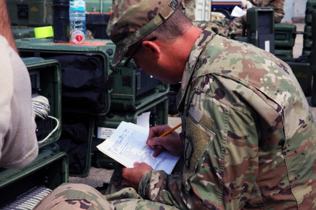 U.S. Army Sgt. Timothy Young, assigned to Bravo Company, 151st Expeditionary Signal Battalion, 228th Theater Tactical Signal Brigade, South Carolina National Guard, conducts an equipment inventory May 15, 2018 in Boleslawiec, Poland. The company is on a nine-month deployment to Europe to support 2nd Theater Signal Brigade and U.S. Army Europe with additional tactical and strategic signal capabilities.