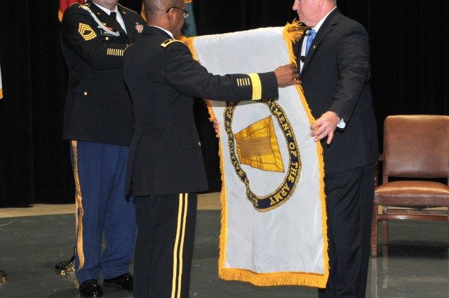 The Senior Executive Service flag was unfurled for Daniel J. Gallagher as ACC-Warren's new executive director with the help of Master Sgt. Mark Hirsch and Maj. Gen. James Simpson on May 14.