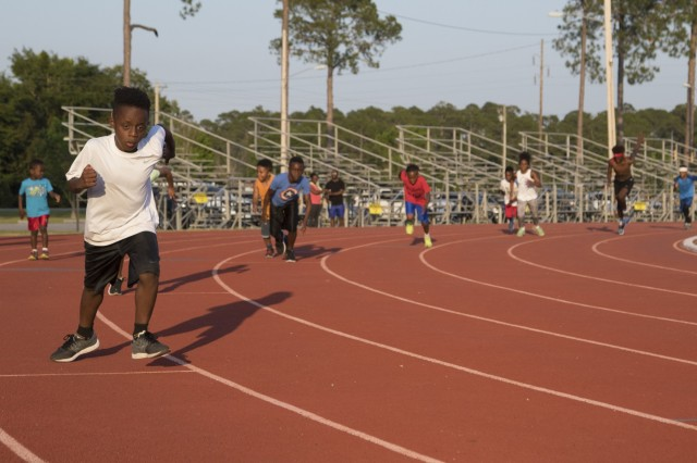 Athletes from the Fort Stewart Rockets track team run during practice, May 9, 2018, at Fort Stewart, Ga. The Rockets recently earned five state championships and are now preparing themselves for nationals at the ESPN Wide World Sports Complex in Orlando, Florida. (U.S. Army photo by Spc. Zoe Garbarino/Released)