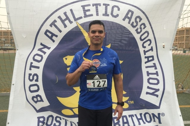 U.S. Army Lt. Col. Roberto R. Sanchez of the 20th Chemical, Biological, Radiological, Nuclear, Explosives (CBRNE) Command, Aberdeen Proving Ground, Maryland, shows off his finisher's medal after completing the 2017 Boston Marathon shadow run at Camp Arifjan, Kuwait. Sanchez, a native of New York City, participated in the 2018 Boston Marathon in Boston, Massachusetts April 16.