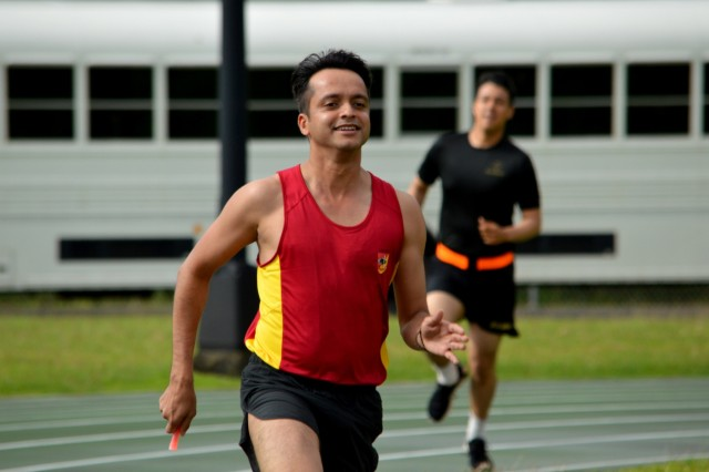 A Singapore Army Soldier competes in a relay race during Tiger Balm 18's sports day at the 298th Regiment, Multi-Functional Training Unit (MFTU), Regional Training Institute (RTI), Waimanalo, Hawaii, on May 15, 2018. Singapore Soldiers assigned to the 6th Division, Singapore Army and 10th Singapore Infantry Brigade played a various sporting events with U.S. Soldiers assigned to the 3rd Brigade Combat Team (3BCT), 25th Infantry Division (25ID); the 29th Infantry Brigade Combat Team (29IBCT), Hawaii Army National Guard (HIARNG); 426th Civil Affairs Battalion, California Army National Guard (CARNG). (U.S. Army photo by Staff Sgt. Armando R. Limon, 3rd Brigade Combat Team, 25th Infantry Division)