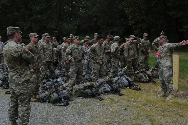 Competitors in the 2018 I Corps Best Warrior Competition prepare to attempt obstacle course during the 2nd day of the competition on May 15, 2018, at Joint Base Lewis-McChord. The course consisted of various physically exhausting obstacles and the soldiers task was to complete the course as quickly as possible. (U.S. Army photo by Sgt. Kyle Larsen)