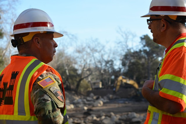 Lt. Gen. Todd Semonite, commanding general, U.S. Army Corps of Engineers, left, talks to a Corps of Engineers Los Angeles District employee, right, about one of the basins he is working at during Semonite's Jan. 18 visit to Montecito, California, to view the disaster caused by a Jan. 9 mudslide.