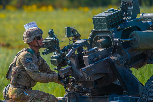 Sgt. Benjamin Rikalo, Bravo Battery, 3rd Battalion, 320th Field Artillery Regiment, 101st Airborne Division Artillery Brigade, 101st Airborne Division, prepares a M119A3 Howitzer to fire during the unit's Table XV gunnery May 2, 2018 at Fort Campbell, Ky.
