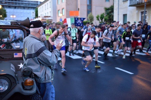 "PESCHIERA DEL GARDA, Italy -- U.S. Army Veteran Rick ""Ranger Rick"" Tscherne sounds the horn officially starting the 2018 Col. Darby 40 Mile Ranger Challenge on April 30th, 2018. Participants must complete a 40 mile route in 12 hours or less, honoring Col. William Darby and 25 other Soldiers from 10th Mountain Division who were among the last Americans to be killed in action in the European theater of WWII."
