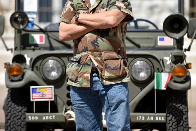 "TORBOLE, Italy -- U.S. Army Veteran Rick ""Ranger Rick"" Tscherne stands in front of his Jeep ""Betsy"", named for his Mother, at the finish line of the Col. Darby 40 Mile Ranger Challenge. Tscherne is credited with starting the memorial event challenge. Participants must complete a 40 mile route in 12 hours or less, honoring Col. William Darby and 25 other Soldiers from 10th Mountain Division who were among the last Americans to be killed in action in the European theater of WWII."
