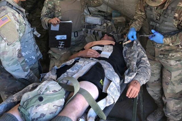 After assessing a casualty, medics from 2-7 CAV, prepare the casualty for treatment by the attending physician assistant during the MASCAL exercise on McGregor Training Complex, New Mexico, May 4. The training was part of the Multi-Echelon Integrated Brigade Training that the 155th ABCT is currently undergoing to prepare for its upcoming deployment in support of Operation Spartan Shield.