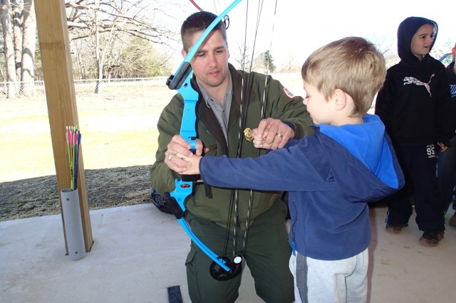 Devin Holt, Kansas City District park ranger at Pomme de Terre Lake, provides assistance during an archery clinic hosted at the Pomme de Terre Archery Range near Hermitage, Missouri. Photo by U.S. Army Corps of Engineers, Kansas City District.