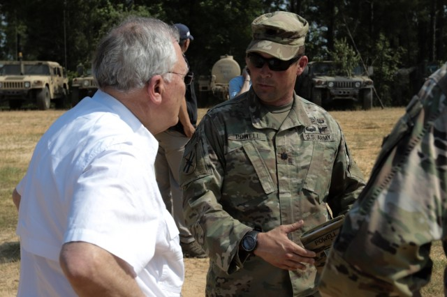 Fort Polk, La., May 15, 2018 - Georgia Army National Guardsman, Lt. Col. Christopher S. Powell, executive officer, 48th Infantry Brigade Combat Team, Macon, Ga., guides Gov. Nathan Deal of Georgia around the brigade's command post area.  Deal visited approximately 200 Georgia Guardsmen during the mornings visit.