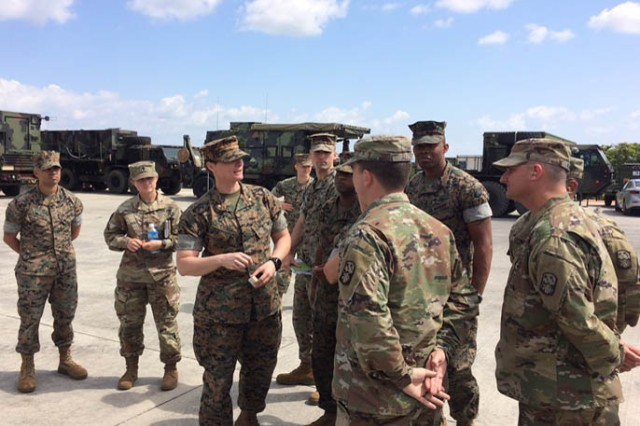 Soldiers from Bravo Battery, 1st Battalion, 1st Air Defense Artillery Regiment and Marine Air Support Squadron 2 communicate as part of an exchange program between both units on Kadena Air Base in Japan, Mar. 19, 2018. The two units partnered together in Okinawa, Japan in a two-week exchange program from Mar. 19-30.