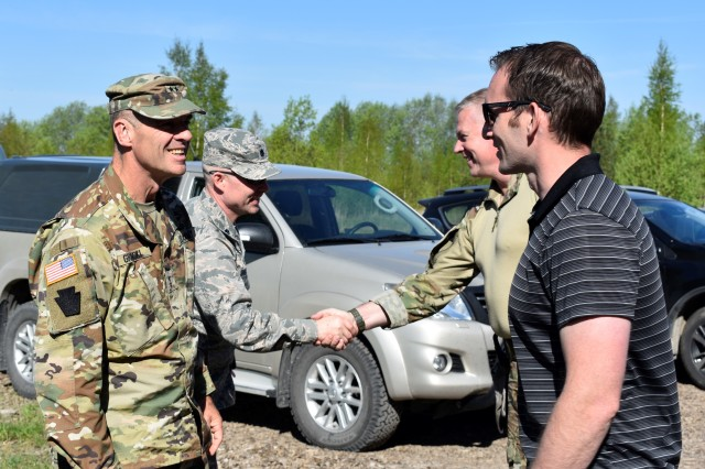 Maj. Gen. John L. Gronski, Deputy Commanding General for Army National Guard, U.S. Army Europe, visits Estonian Defense Forces and Maryland Guard soldiers from the 629th Expeditionary Military Intelligence Battalion and 20th Special Forces Group May 12, 2018 during Exercise Hedgehog 18 in southern Estonia.