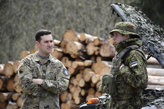 629th Expeditionary Military Intelligence Battalion headquarters company commander, Capt. Andrew H. Self, meets with Estonian Defense Force personnel on May 5th in Southern Estonia. Self served as the U.S. military liaison officer to exercise Hedgehog 18. Photo by Maj. Kurt M. Rauschenberg, 58th EMIB Public Affairs Officer.
