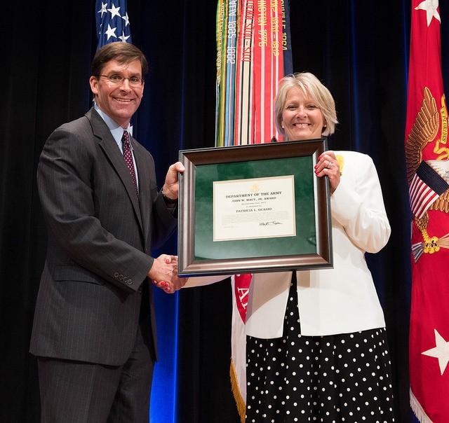 Dr. Mark T. Esper awards Ms. Patricia L. Ocasio with John W. Macy, Jr. Award