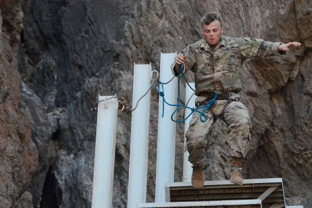 "A Soldier from the Texas Army National Guard completes an obstacle on ""Voie de L'Inconscient"" or ""Path of the Unconscious"", the final evolution of the initial phase of the French Desert Commando Course at the Centre Dentrainment Au Combat Djibouti in Arta Plage, Djibouti, April 23, 2018.  The four-day phase is the first of two necessary to earn the coveted French Desert Commando Badge."