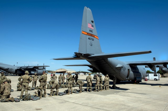 U.S. Army paratroopers from the Texas Army National Guard 1st Battalion (Airborne), 143rd Infantry Regiment, stationed at Camp Swift in Bastrop, Texas, prepare to load onto a C-130H Hercules aircraft, during the Minuteman Joint Forcible Entry exercise at Naval Air Station Joint Reserve Base Fort Worth, Texas, April 20, 2018. The exercise was conducted in coordination with the Illinois Air National Guard's 182nd Airlift Wing and the Texas Army National Guard in order to practice a joint tactical operation.