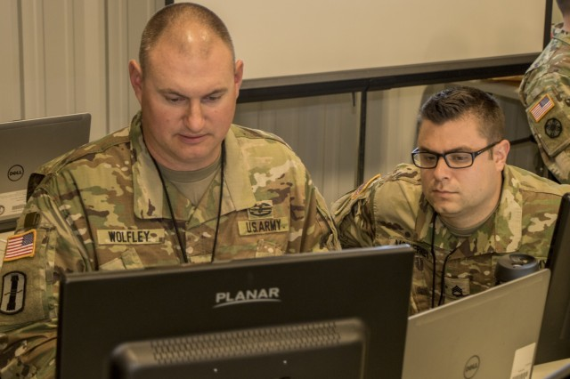 Staff Sgts. Chris McInerny and Kade Wolfley, both Information Technical Specialists, assess a potential threat on Wednesday, May 16 at Cyber Shield, Camp Atterbury, Ind. Cyber Shield 18 is an Army National Guard exercise designed to assess Cyber Warriors on response plans to cyber incidents and features over 800 Soldiers and Airmen.