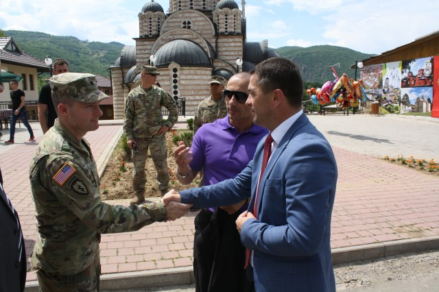 Lt. Col. Donald Braman, commander of 3rd Squadron, 61st Cavalry Regiment, 2nd Infantry Brigade Combat Team, 4th Infantry Division, meets Leposavic Mayor Zoran Todic during the Saint Vasilije Ostroski Festival on May 19 in Leposavic, Kosovo. The 3-61 CAV is the main maneuver element for KFOR's Multi-National Battle Group - East.