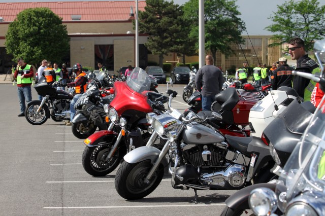Motorcyclists examine their bikes before the start of the 13th annual Freedom's Thunder Motorcycle Safety Rally and Ride May 11, 2018, at the Sheridan Theater parking lot. Sixty riders, mostly Soldiers, along with their mentors traversed the 17.3-mile route in one hour and 10 minutes.