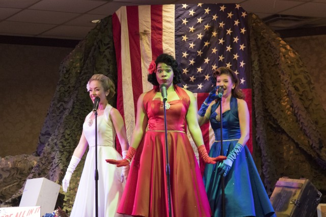 The Victory Belles, (from left to right) Courtney Anderson, Jessica Mixon and Mandi Rigell, sing patriotic and period tunes May 11 at the NCO Club.