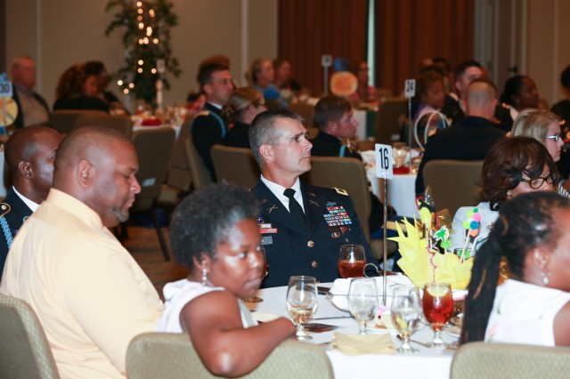 FORT BENNING, Ga. (May 17, 2018) -- Col. Clinton W. Cox, U.S. Army Garrison Fort Benning commander, listens to a speaker during the Partners in Education event. Along with other community groups in the Columbus, Georgia, area, military units from Fort Benning, Georgia, received recognition for their work partnering with local schools during the 2018 Partners in Education Awards May 10, 2018, in downtown Columbus. (U.S. Army photo by Markeith Horace, Maneuver Center of Excellence, Fort Benning Public Affairs)