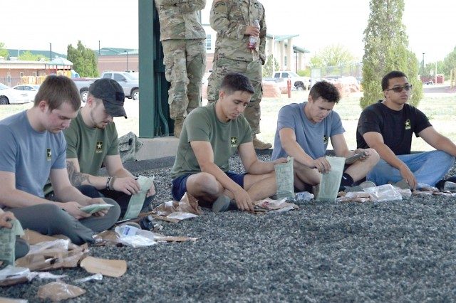 FORT CARSON, Colo. - Future Soldiers break for lunch and learn how to prepare a Meal Ready-to-Eat during the Future Soldier Mega Event at Pershing Field May 12, 2018. (Photo by Scott Prater)