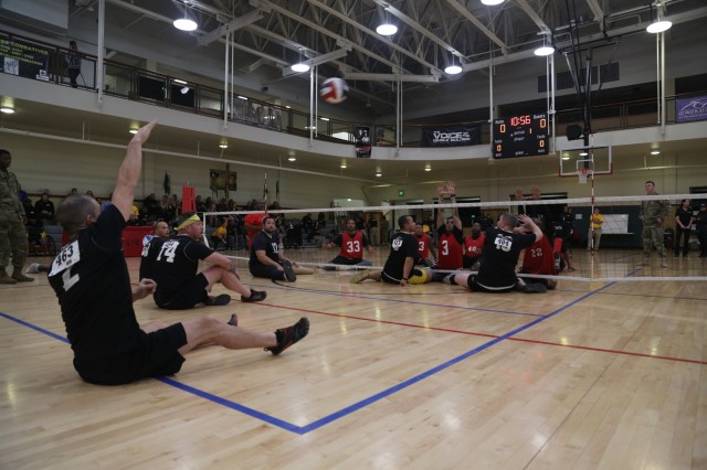 U.S. Army Staff Sgt. Shawn Runnels assigned to Warrior Transition Battalion, Fort Riley, Kansas serves the ball during a volleyball competition for the 2018 Army Trials at Fort Bliss, Texas, March 3, 2018. 74 wounded, ill, or injured active duty Soldiers and veterans participate in a series of events that are held at Fort Bliss, Texas, Feb. 27 through March 9, 2018, as Deputy Chief of Staff, Warrior Care and Transition hosts the 2018 U.S. Army Trials. (U.S. Army photo by Pfc. Tescia Mims)