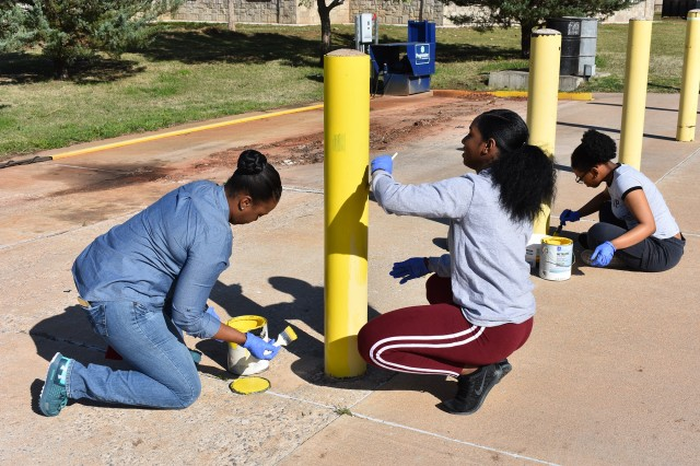 Soldiers from the 100th Brigade Support Battalion paint poles in the parking lot of the Lawton/Fort Sill Veterans Center April 27, 2018. The outreach was one of the numerous projects 75th Field Artillery Brigade Soldiers performed throughout the year.
