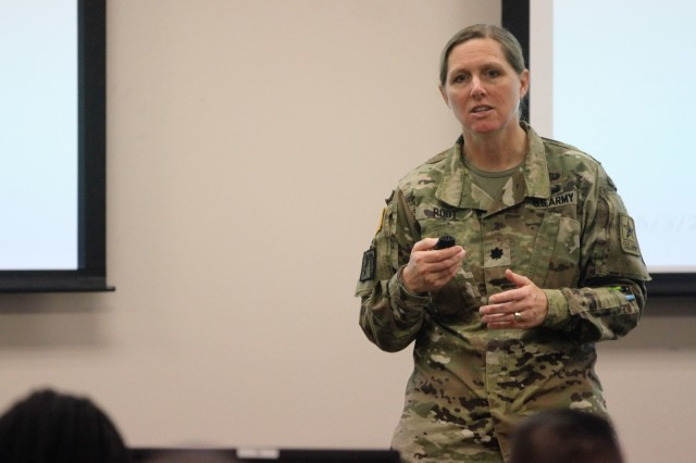 Lt. Col. Sara Root, chief of the Army's Military Justice Legislation Training Team, assigned to office of The Judge Advocate General-criminal law division, briefs commanders and first sergeants May 5-6 on the changes to the Uniformed Code of Military Justice inside the Roc Drill Facility at Joint Base San Antonio-Fort Sam Houston, Texas. During the two-day course, attendees learned about the Military Justice Act of 2016, which will take effect Jan. 1, 2019. (Photo by Staff Sgt. Tomora Nance, U.S. Army North)