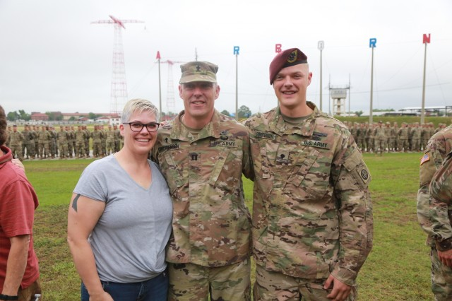FORT BENNING, Ga. (May 17, 2018) -- From left, Jessica Christenson stands with husband Chaplain (Capt.) Matthew Christensen and son Spc. Caleb Christensen. Chaplain (Capt.) Matthew Christensen, 1st Battalion, 50th Infantry Regiment, received airborne wings from his son Spc. Caleb Christensen, an infantryman assigned to 1st Battalion, 504th Parachute Infantry Regiment, May 17 during an Airborne School graduation ceremony on Eubanks Field at Fort Benning, Georgia. (U.S. Army photo by Markeith Horace, Maneuver Center of Excellence, Fort Benning Public Affairs)
