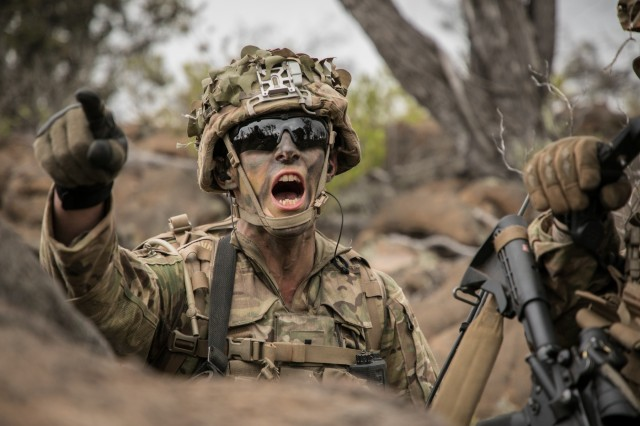 U.S. Army 1st Lt. Bret Brunco assigned to 2nd Squadron, 14th Calvary Regiment, 2nd Infantry Brigade Combat Team, 25th Infantry Division signals his platoon during a Combined Arms Live Fire Exercise (CALFEX) at Pohakuloa Training Area, Hawaii, May 15, 2018. The CALFEX utilizes all the enablers available to the unit in order to increase interoperability, concentrate combat power and mass effects on the objective. (U.S. Army photo by 1st Lt. Ryan DeBooy)