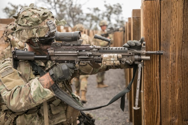 U.S. Army Trooper assigned to 2nd Squadron, 14th Calvary Regiment, 2nd Infantry Brigade Combat Team, 25th Infantry Division returns fire with an M249 Squad Automatic Weapon during a Combined Arms Live Fire Exercise (CALFEX) at Pohakuloa Training Area, Hawaii, May 15, 2018. The CALFEX utilizes all the enablers available to the unit in order to increase interoperability, concentrate combat power and mass effects on the objective. (U.S. Army photo by 1st Lt. Ryan DeBooy)