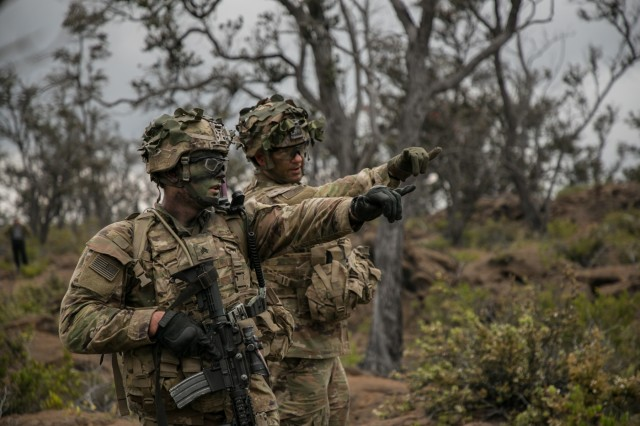 U.S. Army Lt. Col. Tim Peterman, Squadron Commander of 2nd Squadron, 14th Calvary Regiment, 2nd Infantry Brigade Combat Team, 25th Infantry Division validates the fifteen-degree rule with one of his Trooper's during a Combined Arms Live Fire Exercise (CALFEX) at Pohakuloa Training Area, Hawaii, May 15, 2018. The CALFEX utilizes all the enablers available to the unit in order to increase interoperability, concentrate combat power and mass effects on the objective. (U.S. Army photo by 1st Lt. Ryan DeBooy)