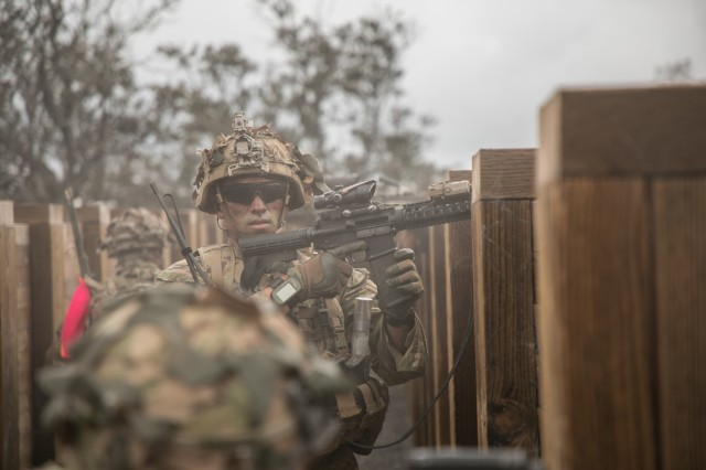 U.S. Army Trooper assigned to 2nd Squadron, 14th Calvary Regiment, 2nd Infantry Brigade Combat Team, 25th Infantry Division begins to change a magazine during a Combined Arms Live Fire Exercise (CALFEX) at Pohakuloa Training Area, Hawaii, May 15, 2018. The CALFEX utilizes all the enablers available to the unit in order to increase interoperability, concentrate combat power and mass effects on the objective. (U.S. Army photo by 1st Lt. Ryan DeBooy)