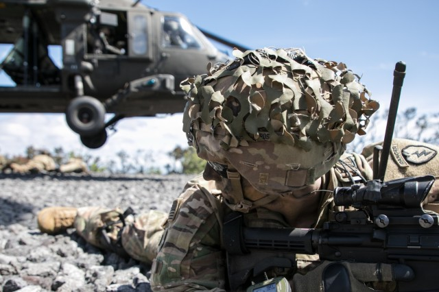 U.S. Army 1st Lt. Bret Brunco assigned to 2nd Squadron, 14th Calvary Regiment, 2nd Infantry Brigade Combat Team, 25th Infantry Division provides security during an air assault movement for a Combined Arms Live Fire Exercise (CALFEX) at Pohakuloa Training Area, Hawaii, May 15, 2018. The CALFEX utilizes all the enablers available to the unit in order to increase interoperability, concentrate combat power and mass effects on the objective. (U.S. Army photo by 1st Lt. Ryan DeBooy)