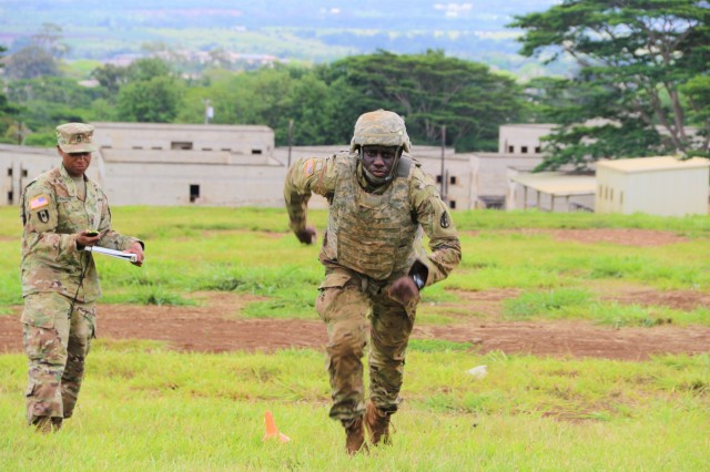 SCHOFIELD BARRACKS, Hawaii (May 15, 2018) - A Regional Health Command-Pacific (RHC-P) Soldier sprints up the field as part of the physical fitness portion of the 2018 RHC-P Best Warrior Competition at a Schofield Barracks shooting range area. Best Warrior is the region's premier competition, designed to identify the command's finest Soldiers, demonstrating commitment to Army values, embodying the Warrior Ethos and representing the force of the future.