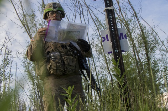 Army Staff Sgt. Patrick Braunshausen, a cavalry observer coach/trainer with 1st Maneuver Battalion, 360th Regiment, 5th Armored Brigade, prepares to document his first grid point find during the day land navigation event at the First Army Best Warrior Competition, hosted by the 4th Cavalry Multi-Functional Training Brigade at Fort Knox, Ky., March 15, 2018. At the end of the three-day competition Braunshausen said land navigation was the most difficult event for him to complete. (U.S. Army photo by Sgt. 1st Class Darron Salzer, First Army Division East)