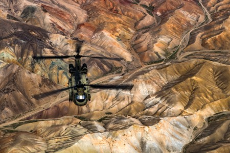 A U.S. Army Task Force Brawler CH-47F Chinook flies while conducting a training exercise with a Guardian Angel team assigned to the 83rd Expeditionary Rescue Squadron at Bagram Airfield, Afghanistan, March 26, 2018. The Army crews and Air Force Guardian Angel teams conducted the exercise to build teamwork and procedures as they provide joint personnel recovery capability, aiding in the delivery of decisive airpower for U.S. Central Command.