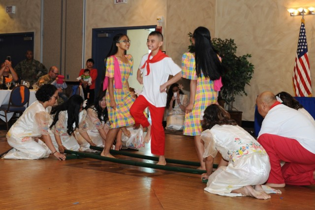 Traditional to the celebration of Asian American and Pacific Islander Heritage Month, attendees at the observance at Fort Drum on May 16 were treated to cultural music and dance performed by the Mabuhay Filipino-American Club of Northern New York and the Toa o Samoa dance group, which is comprised of 10th Mountain Division (LI) Soldiers and Family Members.