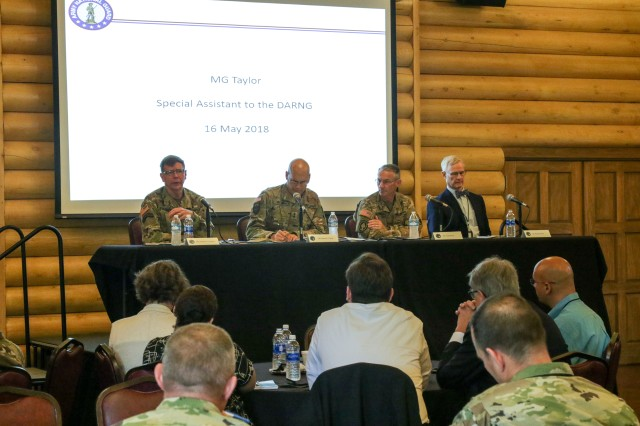 Senior military leaders speak on a panel about the National Guard's role in the U.S. military's cyber mission force May 16, 2018, as part of Cyber Shield 18, in Camp Atterbury, Ind., an exercise bringing together more than 800 soldiers, airmen, and civilians from 40 states and territories to test their skills in response to cyber-incidents. The panel included (from left to right) Maj. Gen. Stephen G. Fogarty, the commander of U.S. Army Cyber Command, Maj. Gen. James E. Taylor, the special assistant to the Director of the Army National Guard for Operations, Plans, and Strategy, Brig. Gen. Neil S. Hersey, the Commandant of the U. S. Army Cyber School, and Dr. Russell Glen, the director of plans and policy G-2 at U.S. Army Training and Doctrine Command.