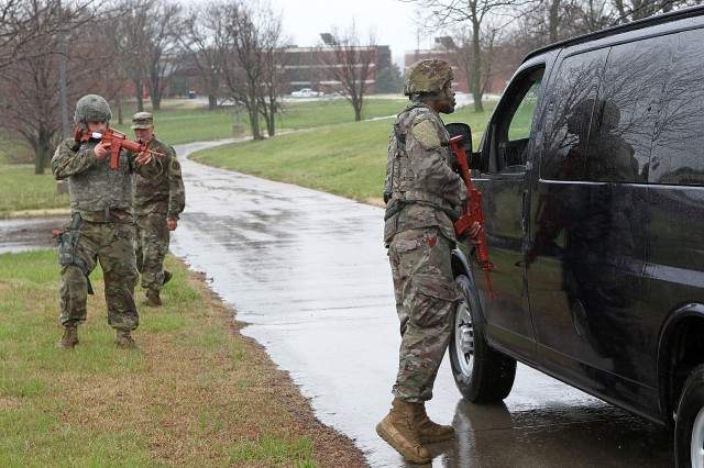 'Big Red One' Soldiers conduct a vehicle checkpoint and extraction April 25 during the Combatives Master Trainer Course held on Fort Riley, Kansas, during the month of April. (Chad L. Simon, 1st Inf. Div. Public Affairs)