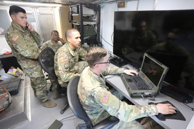 Sgt. Hernan Davilaleon (middle right), fire direction specialist for Bravo Battery 2nd Battalion, 18th Field Artillery Regiment, supervises Spec. Talon Tuszynski (right), as he creates and processes a fire mission for the M142 High Mobility Artillery Rocket System (HIMARS) launcher loaded with the new M57E1 Army Tactical Missile Systems (ATACMS) Modification (MOD). Simultaneously, Sgt. Andrew Cardenas (left), and 1st Lt. Tarell Roberts (middle left), conduct radio operations at White Sands Missile Range, N.M.