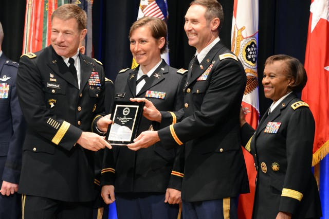 Vice Chief of Staff of the Army Gen. James C. McConville presents the Gold award to Ohio Army National Guard leaders at the Army Communities of Excellence Awards ceremony at the Pentagon, May 18, 2018. Lt. Gen. Gwen Bingham, assistant chief of staff for Installation Management (right), also participated in the ceremony.