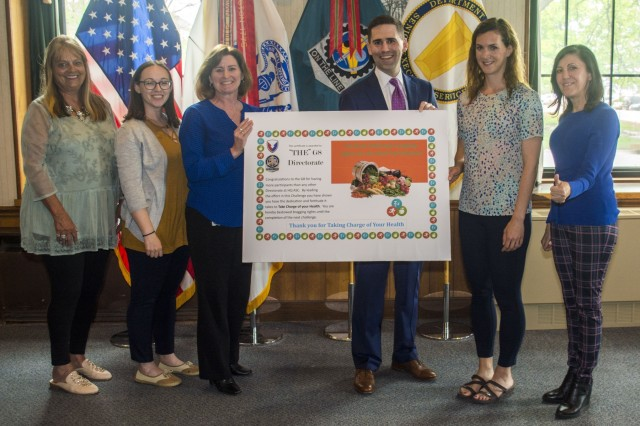 "Employees from ASC G8 (Resource Management) and Matt Sannito, ASC's executive director for Support Operations, pose with the ""Bragging Rights Award"" presented to G8 for having the most participants in the Fit Food Challenge.  The initiative wrapped up on May 14 with a ceremony honoring the 218 employees from ASC and other organizations on Rock Island Arsenal who completed the challenge, sponsored by ASC's Wellness Division. (Photo by Linda Lambiotte, ASC Public Affairs)"