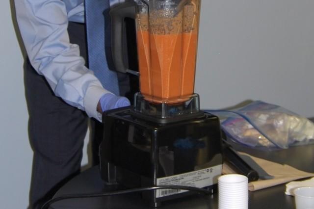 "Lee Hansen checks his blender as he prepares a carrot cake smoothie on ""Smoothie Day,"" an event held April 12 in conjunction with the Fit Food Challenge. (Photo by Paul Levesque, ASC Public Affairs)"